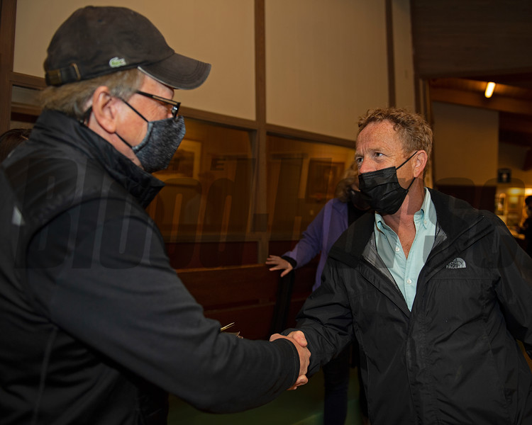 (L-R): Buyer Larry Best is congratulated by Neal Clarke with Bedouin after sale of Hip 670 colt by Good Magic out of Inlovewithlove from Bedouin Bloodstock<br /> Sales horses at the Keeneland November Sale at Keeneland in Lexington, Ky. on November 11, 2020.
