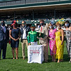 Presentation: assistant trainer Whit Beckman, third from left, presenter Rob Samuels, fifth from left. Raging Bull with Irad Ortiz Jr. wins the Makers Mark Mile (G1)<br /> at Keeneland near Lexington, Ky., on April 9, 2021.