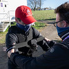 Nathan Horrocks with Equine Productions sets up a Jockey Camera on assistant trainer Jaime Insole during testing of the unit which will be used during Breeders' Cup competition at Keeneland Race Course Wednesday Nov. 4 2020 in Lexington, KY.  Photo by Skip Dickstein