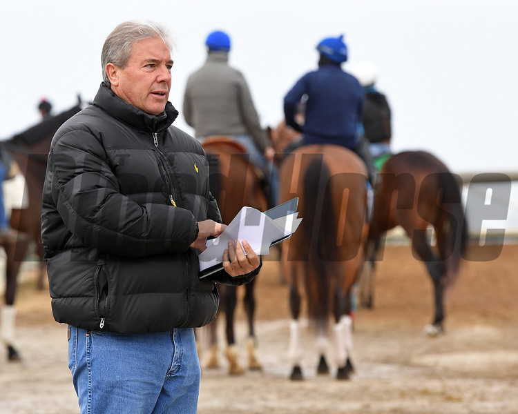 Wesley Ward talking to exercise riders nearing the track.<br /> McCraken with Brian Hernandez Jr. at Keeneland on April 2, 2017. And It's Your Nickel with Jack Gilligan working at Keeneland on April 2, 2017.