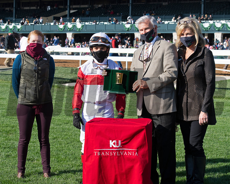 (L-r): Assistant trainer Lindsay Schultz, Joel Rosario and presenters Mr. and Mrs. Paul  (Pamela) Thompson. Scarlett Sky with Joel Rosario wins the Kentucky Utilities Transylvania (G3T)<br /> at Keeneland near Lexington, Ky., on April 2, 2021.