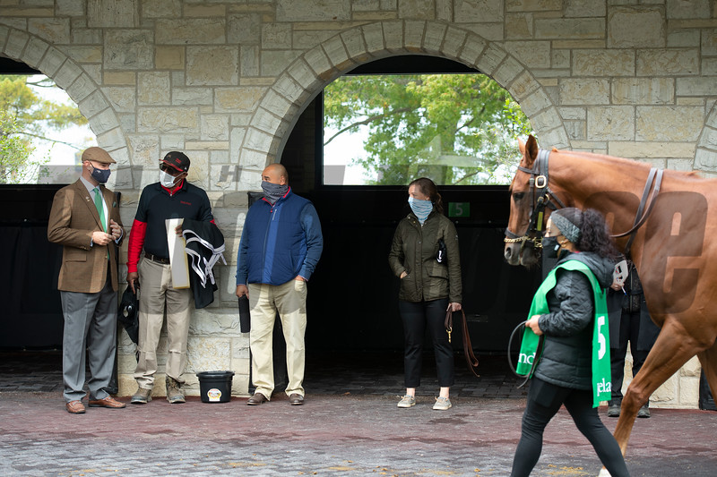 (L-R): The training team, Guiness McFadden, Julio Gondola, Robbie Medina, and Katey Caddel, at Keeneland with Bakers Bay and groom. Robbie Medina saddles and watches #5 Bakers Bay with Tyler Gaffalione in allowance Race 5  at Keeneland on October 18, 2020.