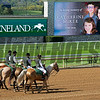 Katherine McKee Memorial, family with Bill Thomason and Shannon Arvin assisting with flower blanket<br /> Opening day of the Keeneland fall meeting on October 2, 2020.