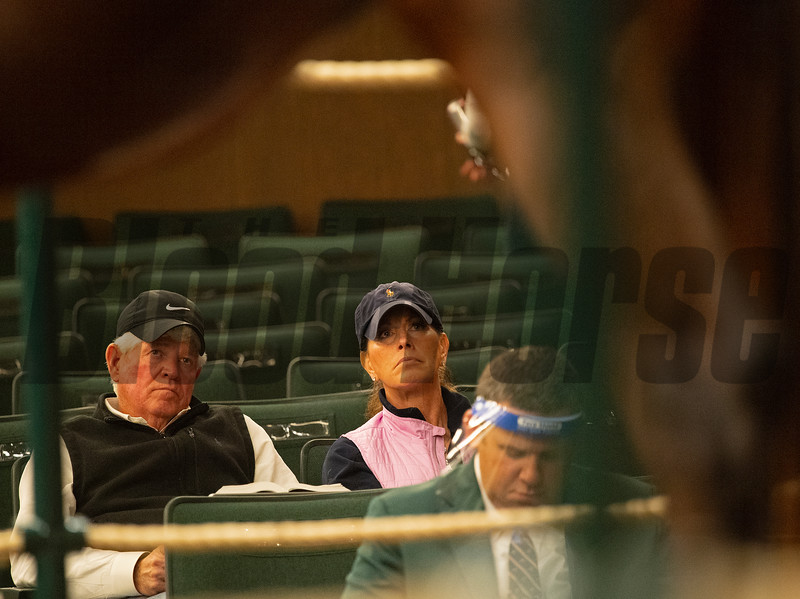 (L-R): Allen Poindexter and Kim Gasparrini watching a mare sell in the ring at Keeneland. <br /> Sales horses at the Keeneland November Sale at Keeneland in Lexington, Ky. on November 10, 2020.