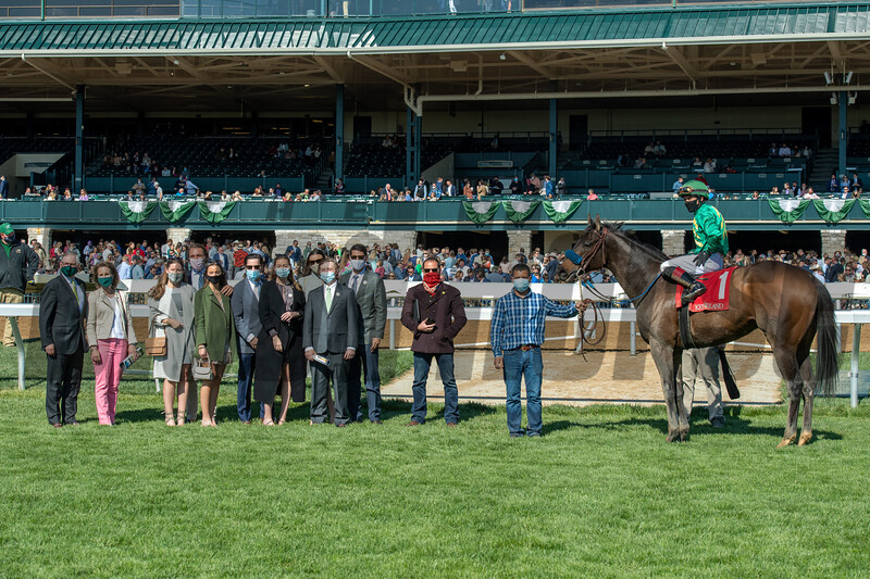The Farish family in the winners circle after Flagstaff with Joel Rosario up, wins the Commonwealth Stakes (G3) at Keeneland on April 3, 2021.