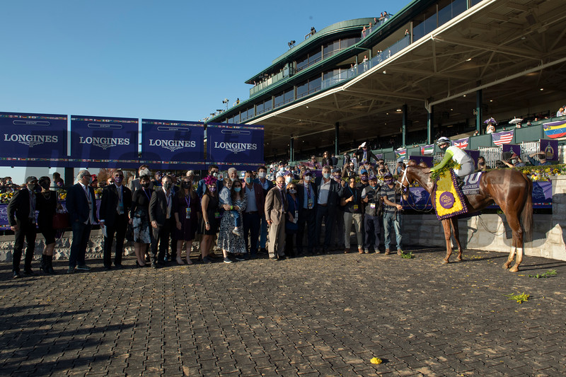 Winning connections of Monomoy Girl with Florent Geroux in the winner's circle for the Breeders' Cup Distaff at Keeneland in Lexington, Ky. on Nov. 7, 2020.
