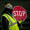 A worker shows the chill of the morning as he directs traffic at the horse crossing at Keeneland Race Course Monday Nov. 2 2020 in Lexington, KY.  Photo by Skip Dickstein