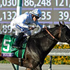 Tourist, with Joel Rosario up, wins the Mile (gr. I) at Santa Anita on Nov. 5, 2016, in Arcadia, California.