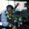 Gary Stevens celebrated winning the Breeders' Cup Classic (G. I) atop Mucho Macho Man. Photo by Crawford Ifland.