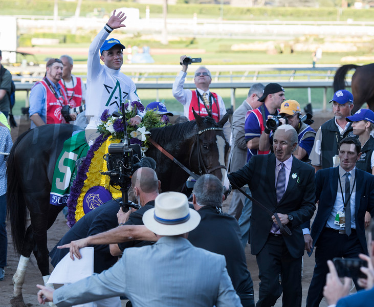 Joel Rosario celebrates after winning the Mile (gr. I) atop Tourist at Santa Anita on Nov. 5, 2016, in Arcadia, California.