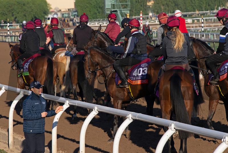 Aidan O'Brien, left, instructing riders of his 14 horses before they turned to gallop<br /> at  Oct. 31, 2019 Santa Anita in Arcadia, CA.