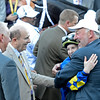 Caption: Napravnik hugs owner Jack Wolf as co-owner Michael Tabor and trainer Todd Pletcher look on. Shanghai Bobby with Rosie Napravnik wins the Grey Goose Juvenile<br /> Breeders' Cup races at Santa Anita near Arcadia, California, on Nov. 3, 2012.<br /> BCRACES2012     Juvenile image149<br /> Photo by Anne M. Eberhardt