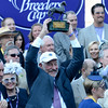 Caption: Co-owner Jack Wolf raises the trophy. Shanghai Bobby with Rosie Napravnik wins the Grey Goose Juvenile<br /> Breeders' Cup races at Santa Anita near Arcadia, California, on Nov. 3, 2012.<br /> BCRACES2012     Juvenile image104<br /> Photo by Anne M. Eberhardt