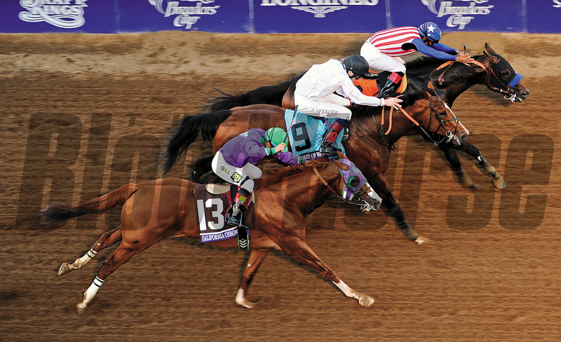 Bayern and jockey Martin Garcia beat Toast of New York with jockey Jamie Spencer and California Chrome with Victor Espinoza to win the Breeders' Cup Classic Saturday at Santa Anita Park on November 1, 2014. <br /> Photo by Wally Skalij