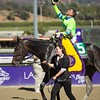 Javier Castellano celebrates winning the Breeders' Cup Juvenile Fillies (G. I) atop Ria Antonia. Photo by Crawford Ifland.