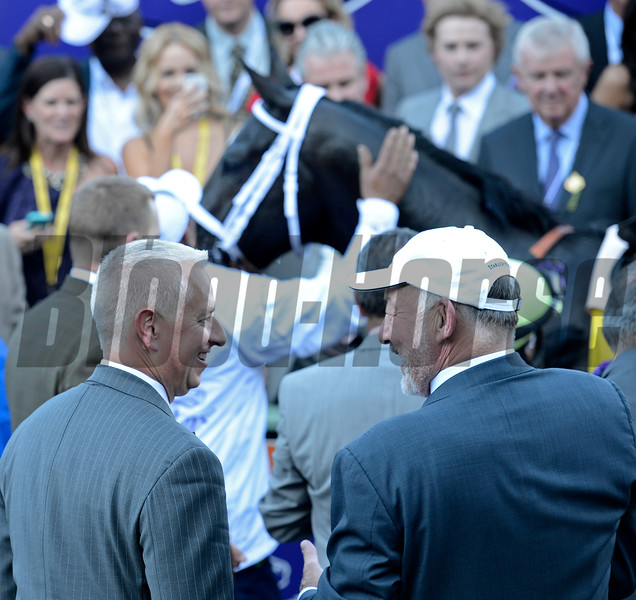 Caption: Trainer Todd Pletcher, left, and co-owner Jack Wolf celebrate with Shanghai Bobby in background. Shanghai Bobby with Rosie Napravnik wins the Grey Goose Juvenile<br /> Breeders' Cup races at Santa Anita near Arcadia, California, on Nov. 3, 2012.<br /> BCRACES2012     Juvenile image128<br /> Photo by Anne M. Eberhardt