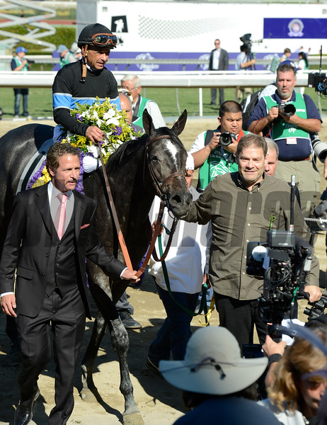 Caption: Mizdirection with Mike Smith wins the Turf Sprint lead in by Jim Rome, left, and trainer Mike Puype<br /> Breeders' Cup races at Santa Anita near Arcadia, California, on Nov. 3, 2012.<br /> BCRACES2012         TurfSprint   image<br /> Photo by Anne M. Eberhardt