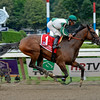 Artemis Agrotera with Rajiv Maragh wins the Ballerina (gr. I) at Saratoga on Aug. 23, 2014.<br /> PHoto by Anne M. Eberhardt