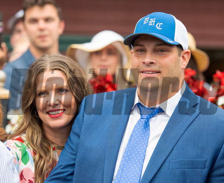 (L-R): Livia Frazar and Brad H.Cox in the winner's circle after Essential Quality with Luis Saez win the Runhappy Travers Stakes (G1) at Saratoga Race Course in Saratoga Springs, N.Y., on Aug. 28, 2021.