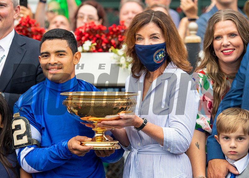 Gov. Kathy Hochul, Livia Frazar and winning connections in the winner's circle after Essential Quality with Luis Saez win the Runhappy Travers Stakes (G1) at Saratoga Race Course in Saratoga Springs, N.Y., on Aug. 28, 2021.