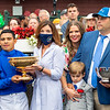 Gov. Kathy Hochul, Livia Frazar, Brad H. Cox and winning connections in the winner's circle after Essential Quality with Luis Saez win the Runhappy Travers Stakes (G1) at Saratoga Race Course in Saratoga Springs, N.Y., on Aug. 28, 2021.