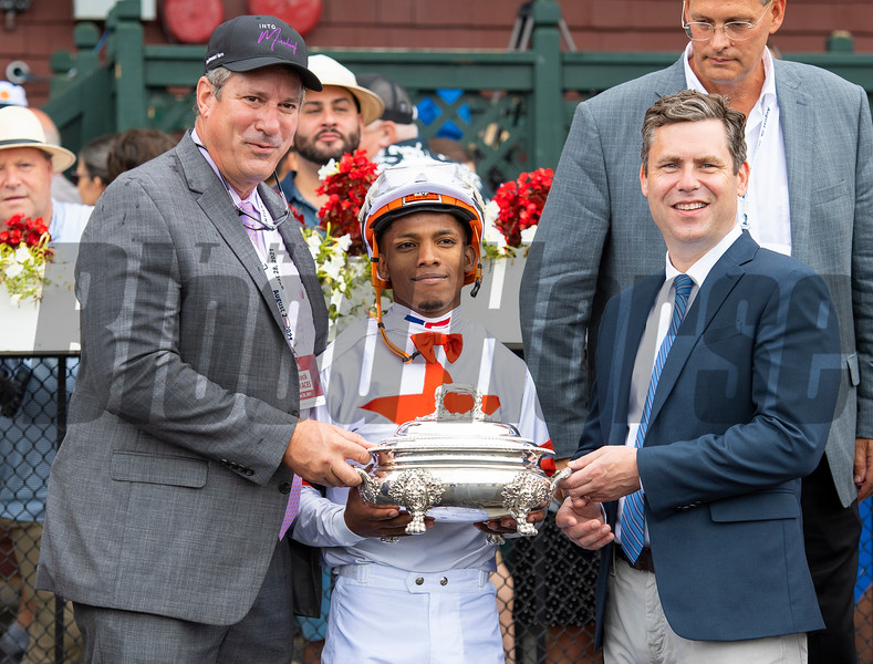 Winning connections and Mark Toothaker (L) in the winner's circle after Yaupon with Ricardo Santana Jr. win the Forego Stakes (G1) at Saratoga Race Course in Saratoga Springs, N.Y., on Aug. 28, 2021.