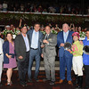 Condo Commando wins the Spinaway Stakes at Saratoga August 31, 2014. Winner's circle with Tom Durkin after his final race call.<br /> Coglianese Photos