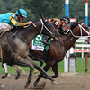 Poseiden's Warrior wins the Alfred G. Vanderbilt Handicap at Saratoga.<br /> Photo by Coglianese Photos