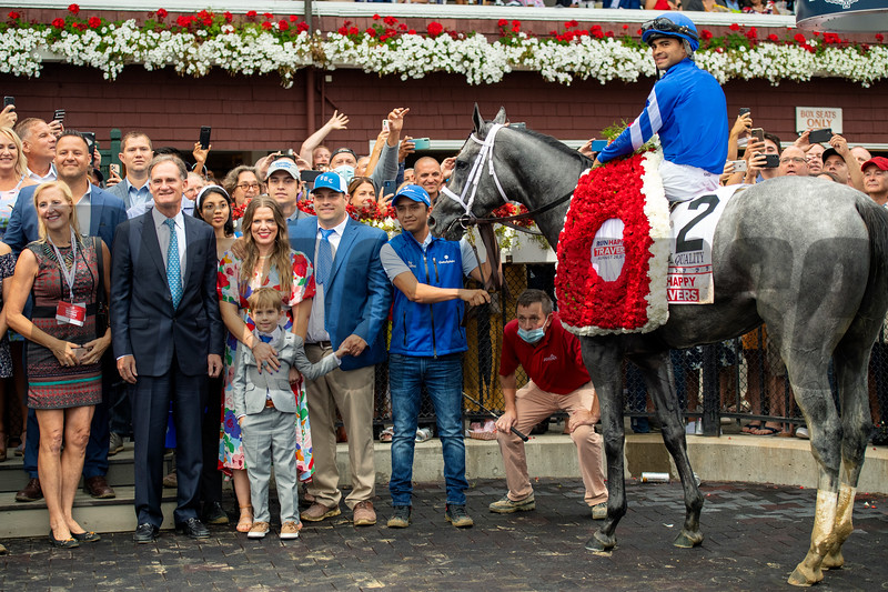Jimmy Bell, Livia Frazar, Brad H. Cox and winning connections in the winner's circle after Essential Quality with Luis Saez win the Runhappy Travers Stakes (G1) at Saratoga Race Course in Saratoga Springs, N.Y., on Aug. 28, 2021.