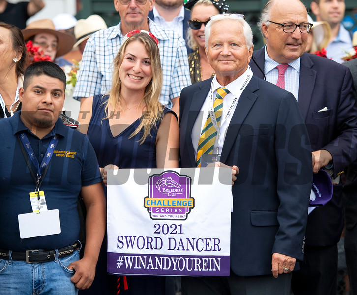 Christophe Clement (R) and winning connections in the winner's circle after Gufo with Joel Rosario win the Resorts World Casino Sword Dancer Stakes (G1T) at Saratoga Race Course in Saratoga Springs, N.Y., on Aug. 28, 2021.