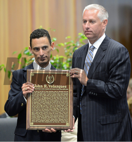 Jockey John Velazquez accepts plaque from presenter Todd Pletcher during his induction to the class of 2012 as new members of the Hall of Fame that attended the induction ceremony held at the Fasig Tipton Sales Pavilion in Saratoga Springs, N.Y. August 10, 2012.  Photo by skip Dickstein