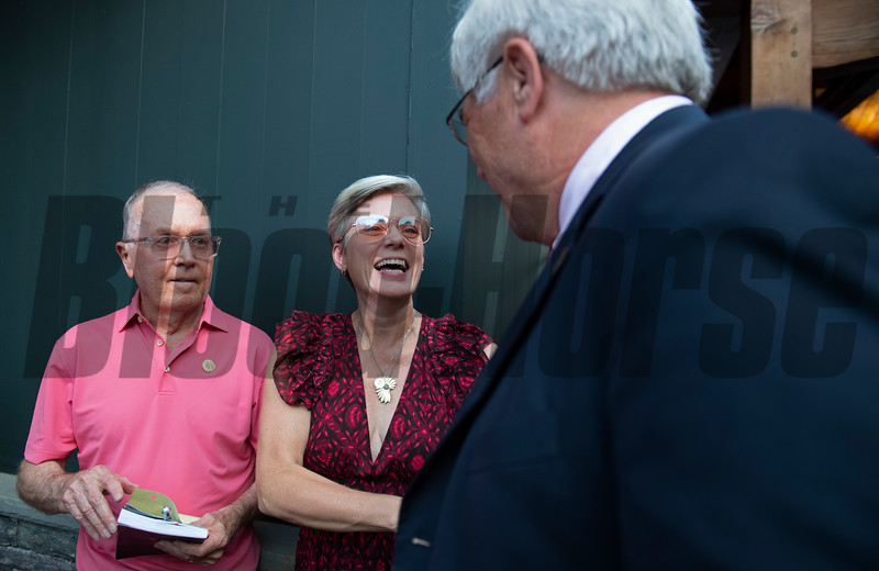 (L-R): Frankie Brothers and Laurie Wolf with Starlight Racing after buying yearling from consignor Doug Arnold<br /> Sales scenes at Fasig-Tipton in Saratoga Springs, N.Y. on Aug. 9, 2021.