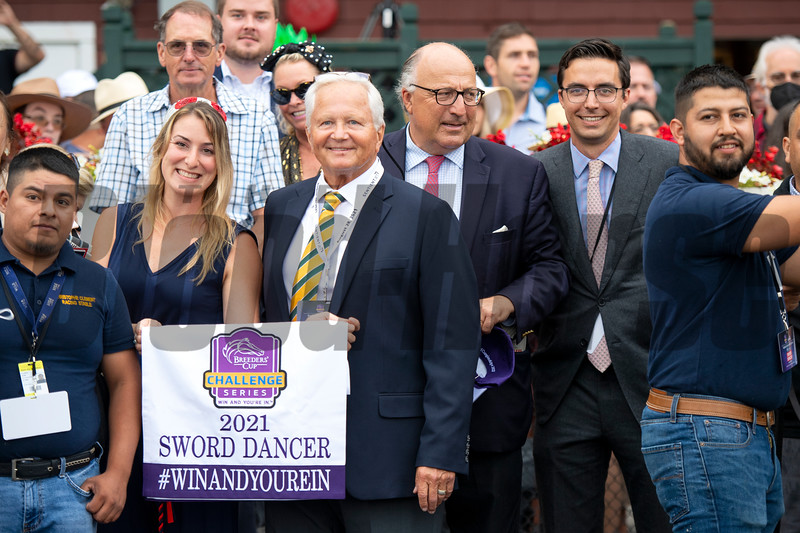 Christophe Clement (C) and winning connections in the winner's circle after Gufo with Joel Rosario win the Resorts World Casino Sword Dancer Stakes (G1T) at Saratoga Race Course in Saratoga Springs, N.Y., on Aug. 28, 2021.