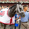 Essential Quality with Luis Saez wins the Runhappy Travers Stakes (G1) at Saratoga Race Course in Saratoga Springs, N.Y., on Aug. 28, 2021.