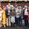 Chandler Carter, Mark Toothaker, Steve Asmussen and winning connections in the winner's circle after Jackie's Warrior with Joel Rosario win the H. Allen Jerkens Memorial Stakes (G1) at Saratoga Race Course in Saratoga Springs, N.Y., on Aug. 28, 2021.