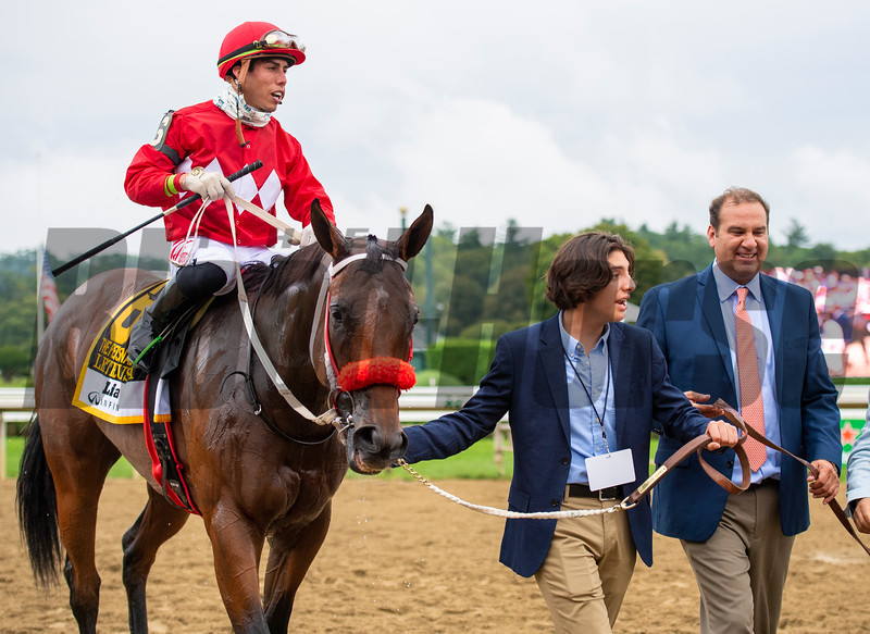Andres Gutierrez and Fausto Gutierrez join Letruska with Irad Ortiz Jr. after win of the Personal Ensign Stakes (G1) at Saratoga Race Course in Saratoga Springs, N.Y., on Aug. 28, 2021.