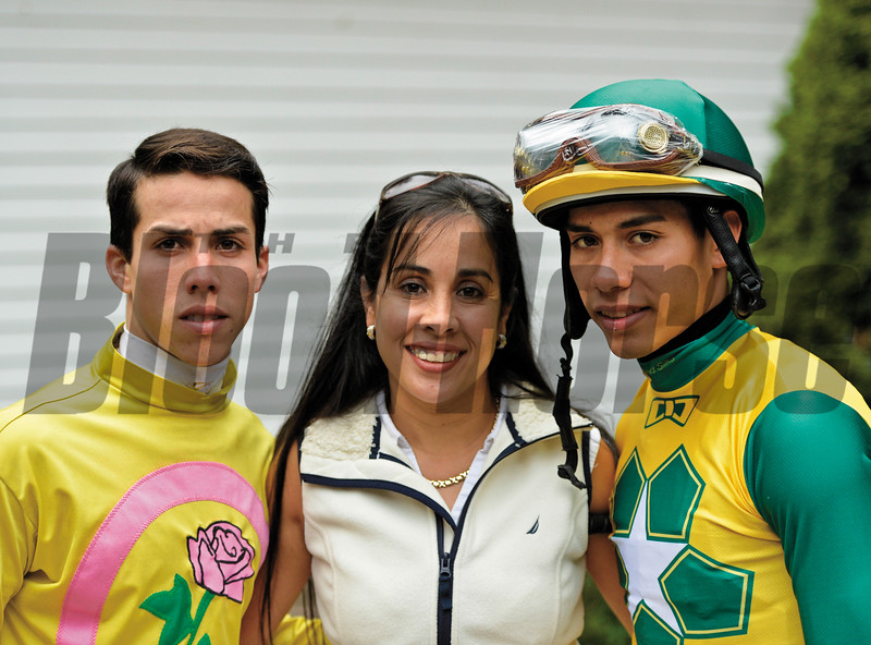 Vilma Ortiz with her son's Irad Ortiz Jr. left and Jose Ortiz right  at Saratoga Race Course Aug. 22, 2014.  Photo by Skip Dickstein