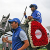 Essential Quality with Luis Saez heading into the Winner's Circle at Saratoga on August 28, 2021 after the 152nd Running of the Travers (GI). Photo By: Chad B. Harmon