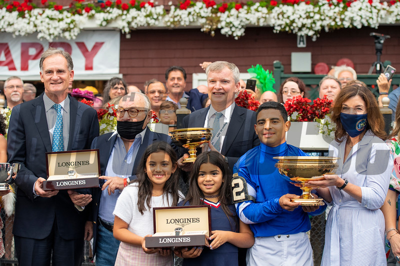 Jimmy Bell, Dan Pride, Gov. Kathy Hochul and winning connections in the winner's circle after Essential Quality with Luis Saez win the Runhappy Travers Stakes (G1) at Saratoga Race Course in Saratoga Springs, N.Y., on Aug. 28, 2021.