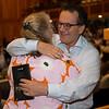 John Sikura hugs Dede McGehee after selling hip 132<br /> Sales scenes at Fasig-Tipton in Saratoga Springs, N.Y. on Aug. 10, 2021.