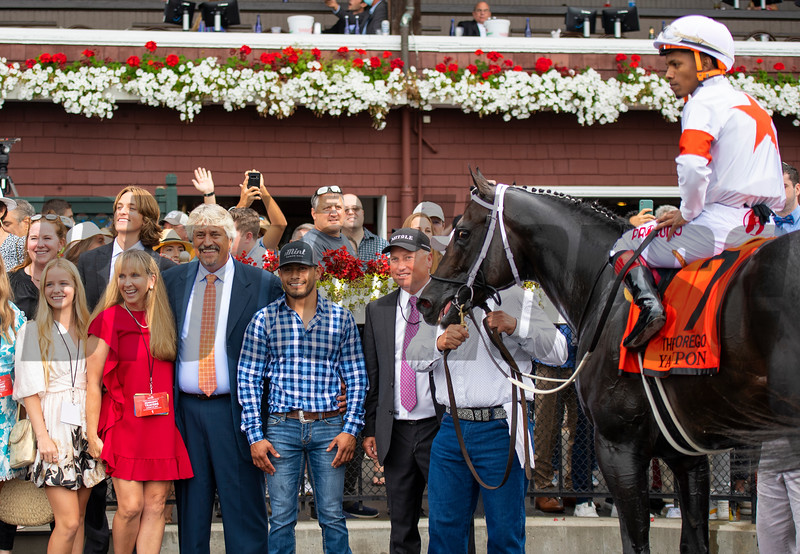 Winning connections and Steve Asmussen in the winner's circle after Yaupon with Ricardo Santana Jr. win the Forego Stakes (G1) at Saratoga Race Course in Saratoga Springs, N.Y., on Aug. 28, 2021.