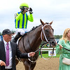 Chandler Carter (R) joins Jackie's Warrior with Joel Rosario after win of the H. Allen Jerkens Memorial Stakes (G1) at Saratoga Race Course in Saratoga Springs, N.Y., on Aug. 28, 2021.