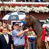 Winning connections in the winner's circle after Gamine with John R. Velazquez win the Ketel One Ballerina Handicap (G1) at Saratoga Race Course in Saratoga Springs, N.Y., on Aug. 28, 2021.