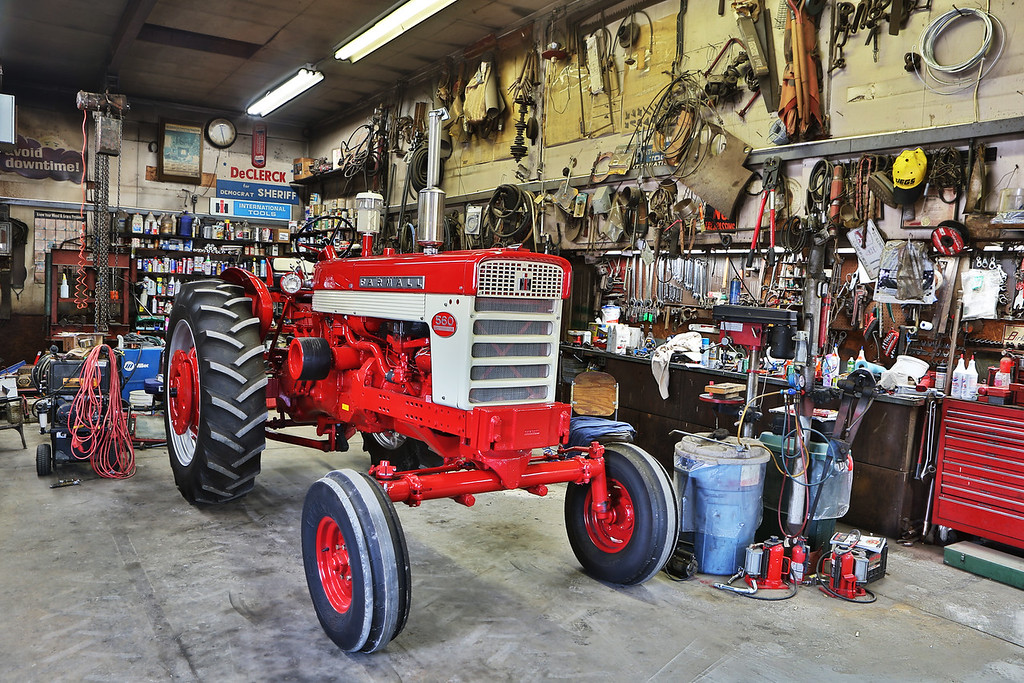 Low-hour Farmall 560 owned by legendary radio and television personality Max Armstrong, shown in the working shop of collector and restorer Darius Harms