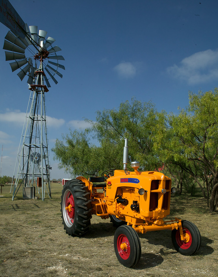 """This 1959 Minneapolis Moline 5 Star Universal Diesel is owned by Bill and Linda Adams of Lubbock, Texas. The tractor was photographed on the grounds of the American Wind Power Center in Lubbock, Texas. You can check out the Wind Power Museum at <a href=""""http://www.windmill.com/"""">http://www.windmill.com/</a>, and the American Museum of Agriculture at <a href=""""http://www.agriculturehistory.org/"""">http://www.agriculturehistory.org/</a>."""