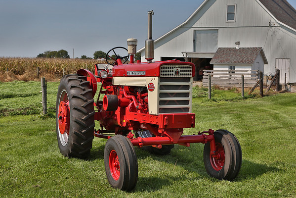 "Print #110<br /> 1962 Farmall 560 owned by radio announcer Max Armstrong<br /> This 560 spent most of it's life in southern Indiana, working on the farm owned by the father of well-known Chicago radio broadcaster Max Armstrong. The tractor was sold to a neighbor in the 1980s. The neighbor flipped the tractor over, and then it sat outside for many years. The 560 was returned to Max a few years ago in rough condition. The FFA chapter from the Prairie Central High School in Fairbury, Illinois restored the tractor to pristine condition, and the family heirloom is now Max's pride and joy. ""The lessons learned will stay with them all their lives,"" Max said. ""I'm proud to be one of the supporters of the FFA."" <br /> CREDIT: Lee Klancher"