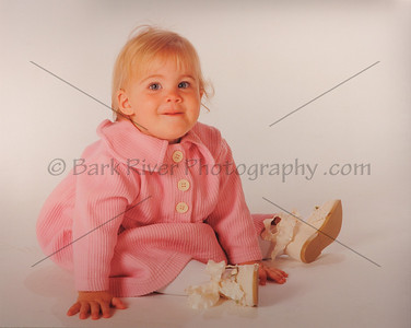 Traditional and Sweet. Picking the right outfit really adds to a childs portrait.