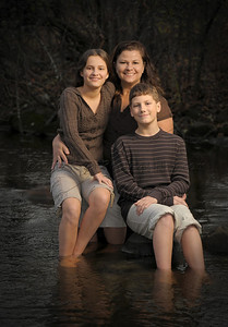We can even pose in the Bark River to create a creative, unique and memorable family portrait for you. The river is right on our property with no travel needed to capture this interesting background.