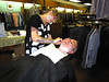 Tom getting a straight-razor shave at Snead's Men's Store from Mallory, a Bakersfield Barber College student.