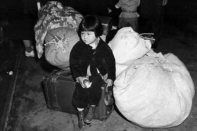 Young Evacuee on Her Way to an Internment Center (California)